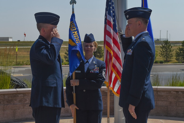 Lt. Col. Andrew Herman, 460th Medical Support Squadron incoming commander, renders his first salute to Col. Matthew Hanson, 460th Medical Group commander, July 7, 2017, on Buckley Air Force Base, Colo. The 460th MDSS provides all administration, information systems and communication, resource management, logistical and facility management, and readiness for the Buckley community. (U.S. Air Force photo by Senior Airman Luke Nowakowski/Released)