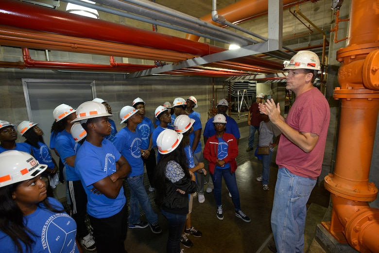 Greg Forte, an Old Hickory power plant senior mechanic, at the Old Hickory Lock and Dam provides NSTI students with information about the interior operations of the Old Hickory Power Plant on June 21, 2017.  Both were part of a group of 17 students who attended the Tennessee State University Engineering Department's four-week NSTI National Summer Transportation Institute program that introduces students to various aspects of engineering.  The U.S. Army Corps of Engineers Nashville District has partnered with the Tennessee State University College of Engineering, Technology and Computer Science Department to mentor science, technology, engineering and math students during a four-week National Summer Transportation Institute program June 20 through July 2 on the campus of TSU.
