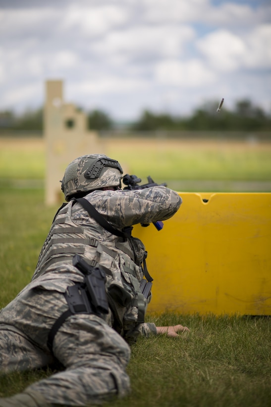 A 914th Security Forces Airman fires an M4 rifle while shielding himself behind a barrier during Security Forces annual training, July 11, 2017, Niagara Falls Air Reserve Station, N.Y. The training focuses on communication and execution of maneuvers, ensuring SFS Airmen are well versed in smoothly and efficiently carrying out procedures in real-world situations. (U.S. Air Force photo by Tech. Sgt. Stephanie Sawyer)