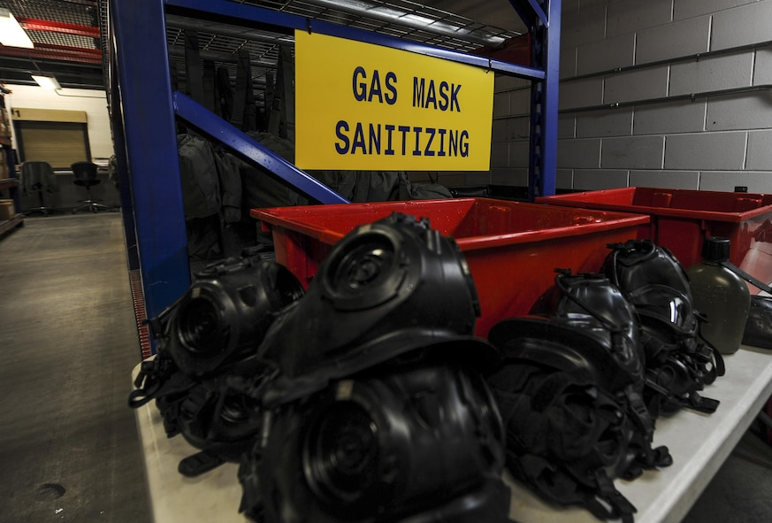 Gas masks are set in place before being put into a sanitizing solution at Hurlburt Field, Fla., July 10, 2017. Material management specialists with the 1st Special Operations Logistics Readiness Squadron use a chlorine solution to wash the gas masks, which are then rinsed in water and set to dry overnight. Once dry, a Joint Service Mask Leakage Tester is used to check for leaks or blocks in the masks. (U.S. Air Force photo by Airman 1st Class Isaac O. Guest IV)