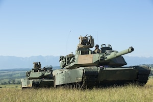 U.S. soldiers with the 1st Battalion, 66th Armor Regiment, 3rd Armored Brigade Combat Team, 4th Infantry Division, maneuver tanks during Getica Saber 2017 in Cincu, Romania, July 10, 2017. Getica Saber 2017 is a U.S.-led fire support coordination exercise and combined arms live fire exercise that incorporates six allied and partner nations with more than 4,000 soldiers. Getica Saber 2017 runs concurrent with Saber Guardian 17, a U.S. Army Europe-led, multinational exercise that spans across Bulgaria, Hungary and Romania with over 25,000 service members from 22 Allied and partner nations. Army photo by Spc. Antonio Lewis