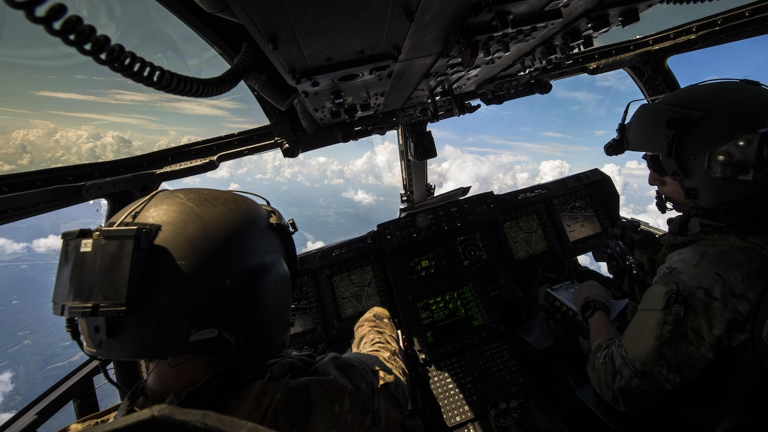 Aircrew with the 8th Special Operations Squadron pilot a CV-22 Osprey tiltrotor aircraft during Total Force Exercise 17-3 above Indiana, July 9, 2017. During the exercise, aircrew with the 8th SOS conducted infiltration and exfiltration of special operations forces and air-to-air refueling missions with a 15th Special Operations Squadron MC-130H Combat Talon II. (U.S. Air Force photo by Airman 1st Class Joseph Pick)