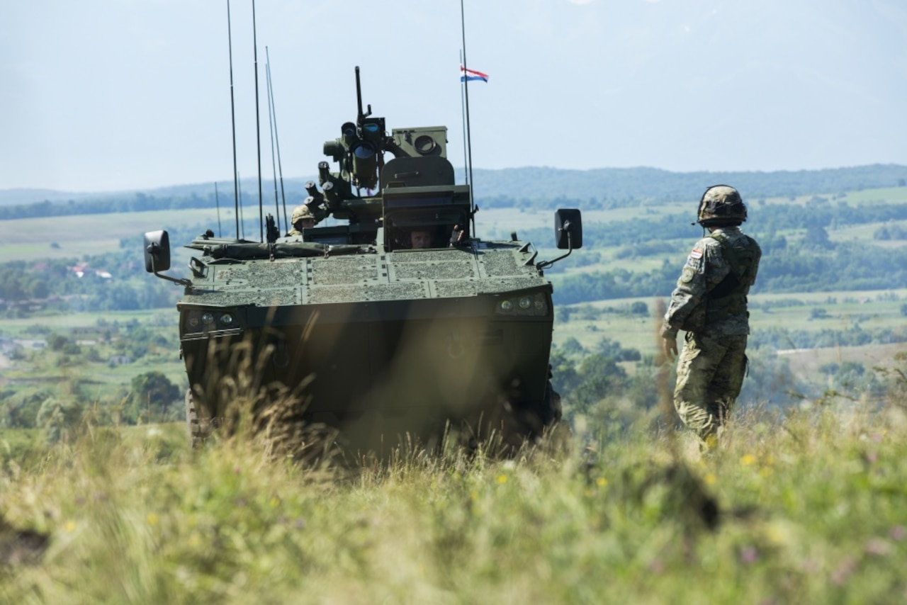 Soldiers of the Croatian armed forces maneuver their armored vehicles during Getica Saber 2017 in Cincu, Romania, July 10, 2017. Getica Saber 2017 is a U.S.-led fire support coordination exercise and combined arms live fire exercise that incorporates six allied and partner nations with more than 4,000 soldiers. Getica Saber 2017 runs concurrent with Saber Guardian 2017, a U.S. Army Europe-led, multinational exercise that spans across Bulgaria, Hungary and Romania with over 25,000 service members from 22 Allied and partner nations. Army photo by Spc. Antonio Lewis