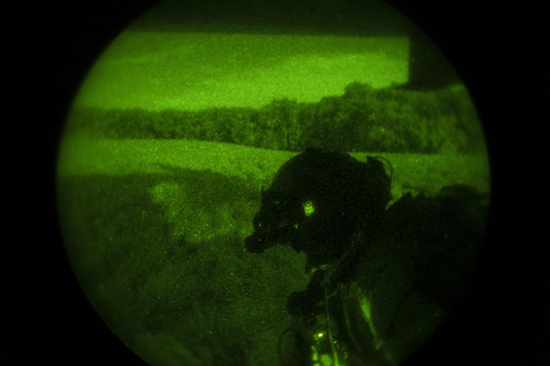 A special missions aviator with the 8th Special Operations Squadron scans for friendly forces during a total force exercise 17-3 infiltration and exfiltration mission at Camp Atterbury, Ind., July 9, 2017. During the exercise, aircrew with the 8th SOS conducted infiltration and exfiltration of special operations forces and air-to-air refueling missions with a 15th SOS MC-130H Combat Talon II. (U.S. Air Force photo by Airman 1st Class Joseph Pick)