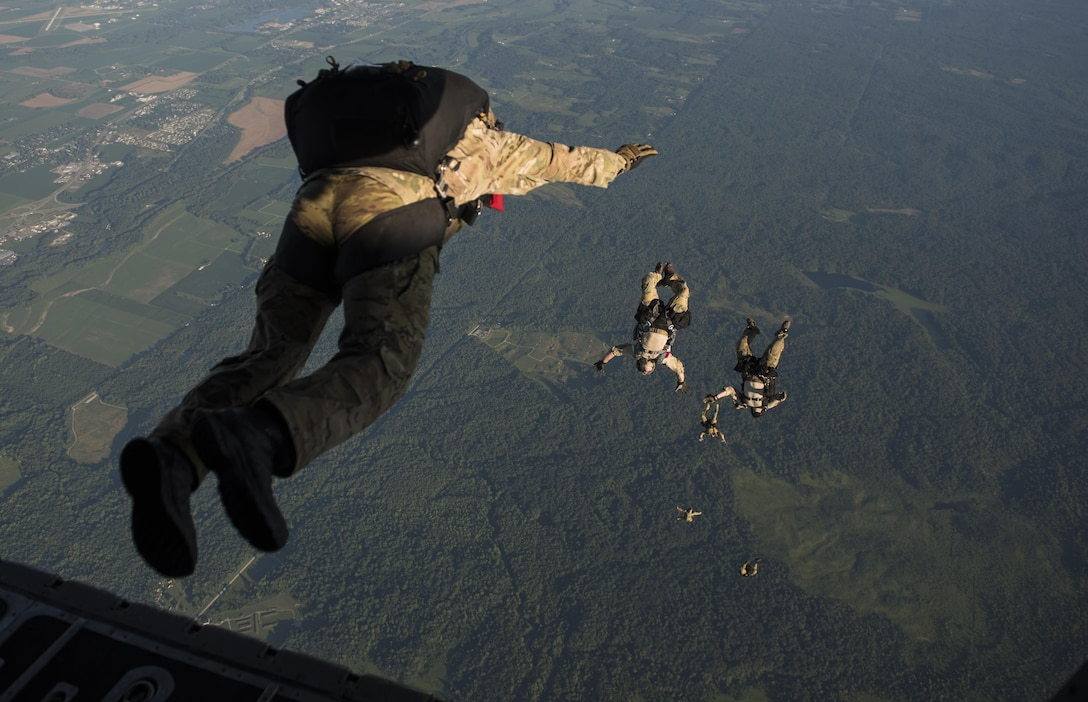 Special Tactics Airmen with the 123rd Special Tactics Squadron, Louisville, KY., execute a high altitude, low open jump out of a 15th Special Operations Squadron MC-130H Combat Talon II, during a total force exercise mission over Terra Haute, Ind., July 8, 2017.  Air Commandos with the 1st Special Operations Wing conduct exercises with joint services to strengthen the development of joint leaders and teams to better understand the synergy of air, space, and cyber power, and how to synthesize the capabilities the air component brings with the other elements of joint and national power. (U.S. Air Force photo by Tech. Sgt. Jeffrey Curtin)