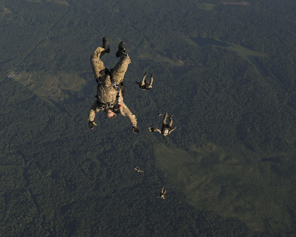 Special Tactics Airmen with the 123rd Special Tactics Squadron, Louisville, KY., execute a high altitude, low open jump out of a 15th Special Operations Squadron MC-130H Combat Talon II, during a total force exercise mission over Terra Haute, Ind., July 8, 2017. If we are taking out the second sentence, we need to add another one...maybe talk about the 123rd mission or the ST mission. (U.S. Air Force photo by Tech. Sgt. Jeffrey Curtin)