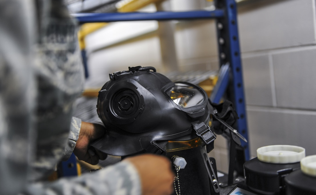 Airman 1st Class Jessica Outlaw, a materiel management journeyman with the 1st Special Operations Logistics Readiness Squadron, uses a Joint Service Mask Leakage Tester to perform a leak test on a gas mask at Hurlburt Field, Fla., July 11, 2017. A JSMLT uses aerosol vapor to check for leaks or blocks on a gas mask. (U.S. Air Force photo by Airman 1st Class Isaac O. Guest IV)