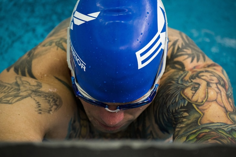 U.S. Air Force veteran Robert Scoggins, a former combat rescue helicopter pilot from Manitou Springs, Colo., prepares to swim during the men's 50-yard backstroke at the 2017 Warrior Games July 8, 2017 at the University of Illinois at Chicago, Chicago, Ill. Scoggins, who earned a bronze medal in his swimming category, also competed in archery and cycling during the 2017 Warrior Games. (U.S. Air Force photo by Staff Sgt. Keith James)