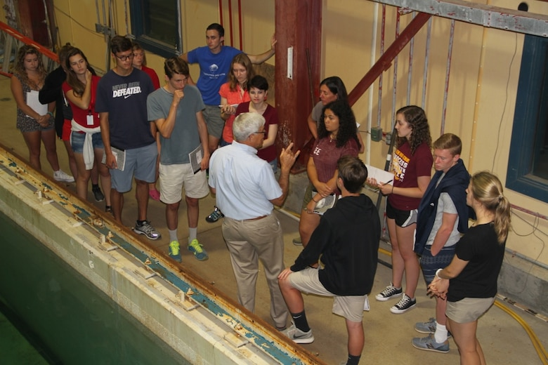 """Research engineer Leonard """"Zab"""" Zabilansky discusses the formulation of experimental design with Advanced Studies Program students from St. Paul's School in Concord, New Hampshire, during a field trip to the U.S. Army Cold Regions Research Laboratory on July 12."""