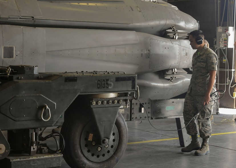Airman 1st Class Dexter Perpose, 705th Munitions Squadron maintenance team member, walks beside a rotary launcher at Minot Air Force Base, N.D., June 30, 2017. The common strategic rotary launcher houses cruise missiles on the B-52H Stratofortress. (U.S. Air Force photo by Airman 1st Class Jessica Weissman)