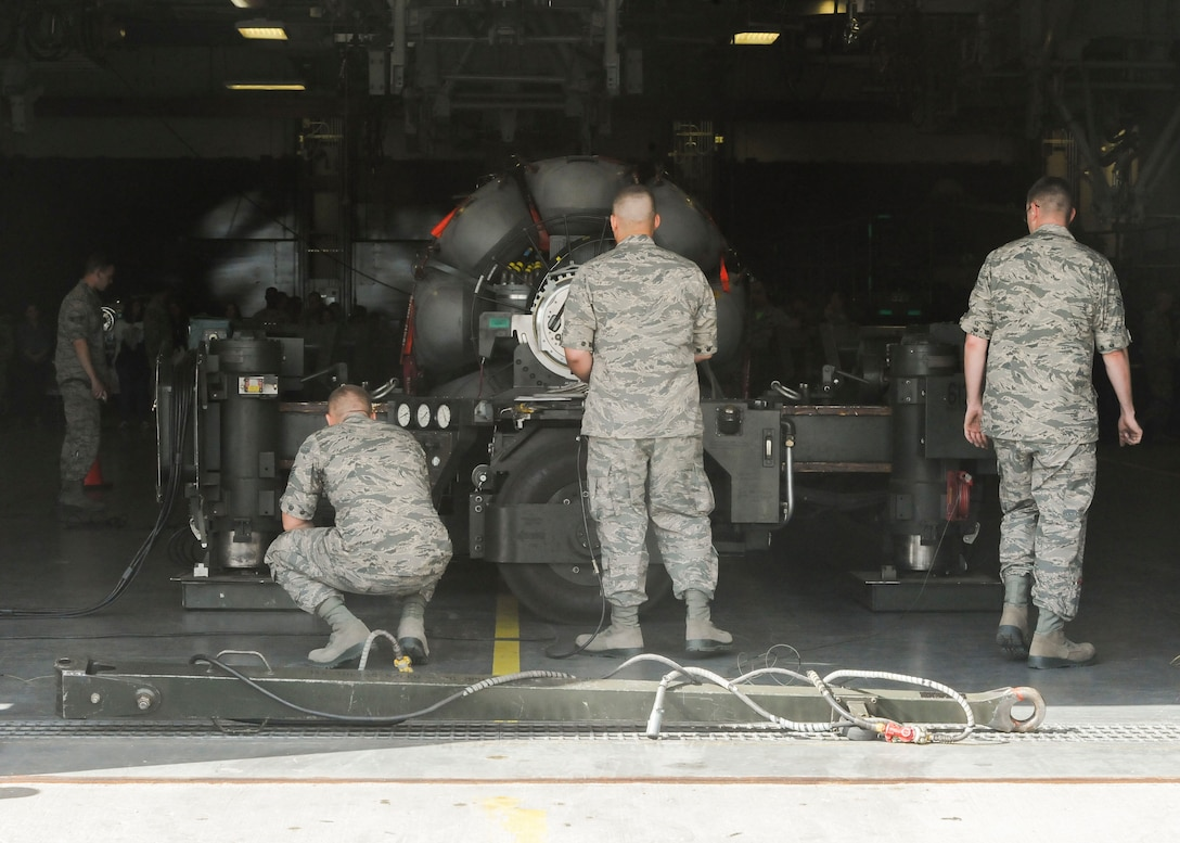 Members of the 705th Munitions Squadron Global Strike Challenge team inspect a rotary launcher at Minot Air Force Base, N.D., June 30, 2017. The common strategic rotary launcher houses cruise missiles on the B-52H Stratofortress. (U.S. Air Force photo by Airman 1st Class Jessica Weissman)