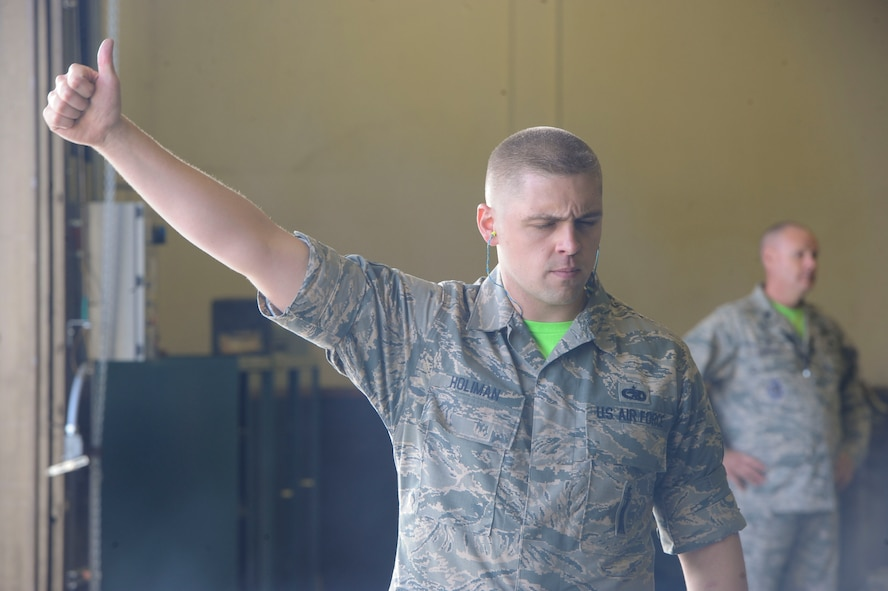 Staff Sgt. Eldin Holiman, 705th Munitions Squadron maintenance team lead, gives a thumbs up during trailer operations at Minot Air Force Base, N.D., June 30, 2017. Holiman is a 705th MUNS 2017 Global Strike Challenge team member. (U.S. Air Force photo by Airman 1st Class Jessica Weissman)