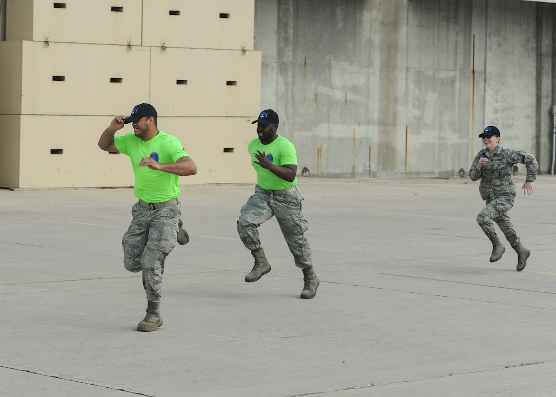 "Members from the 705th Munitions Squadron Global Strike Challenge team run to their vehicle during a practice competition at Minot Air Force Base, N.D., June 30, 2017. The team completed a ""forklift rodeo"" by maneuvering an asset with a forklift. (U.S. Air Force photo by Airman 1st Class Jessica Weissman)"
