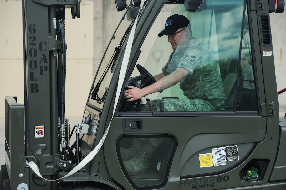 """Staff Sgt. Erich White, 705th Munitions Squadron re-entry systems and re-entry vehicles team member, turns on a forklift at Minot Air Force Base, N.D., June 30, 2017. The 705th MUNS 2017 Global Strike Challenge team completed a """"forklift rodeo"""" by maneuvering an asset with a forklift. (U.S. Air Force photo by Airman 1st Class Jessica Weissman)"""