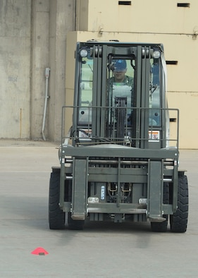 "Staff Sgt. Erich White, 705th Munitions Squadron re-entry systems and re-entry vehicles team member, drives a forklift at Minot Air Force Base, N.D., June 30, 2017. The 705th MUNS 2017 Global Strike Challenge team completed a ""forklift rodeo"" by maneuvering an asset with a forklift. (U.S. Air Force photo by Airman 1st Class Jessica Weissman)"