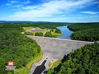 The Prompton Dam was constructed in 1960 to reduce flood risks primarily for the communities of Prompton, Pennsylvania, Hawley, Pennsylvania and Honesdale, Pennsylvania. The 1230-foot long and 147-foot high earthen dam was built in response to severe floods on the Lackawaxen River in 1936, 1942 and 1955.