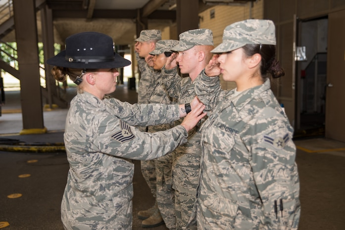 Tech. Sgt. Megan Harper, A 326th Training Squadron military training instructor facilitator, instructs new Airmen on performing a proper salute at the 326th TRS at Joint Base San Antonio-Lackland, Texas June 28, 2017. As a facilitator, Harper's job is to facilitate classes during Airmen's Week, a transitionary character development period between basic military training and technical school when Airmen have the opportunity to apply and internalize the Air Force creed and core values taught during BMT.