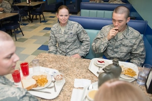 Tech. Sgt. Megan Harper, a 326th Training Squadron military training instructor facilitator (center), eats with Airmen inside the 326th TRS dining facility at Joint Base San Antonio-Lackland, Texas June 23, 2017. As a facilitator, Harper's job is to facilitate classes during Airmen's Week, a transitionary character development period between basic military training and technical school when Airmen have the opportunity to apply and internalize the Air Force creed and core values taught during BMT.