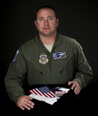 Master Sgt. Joey Myers, 6th Air Refueling Squadron KC-10 Extender flight engineer, displays the items he carries with him around the globe. Men and women serving their country in all branches of the military have traditionally kept meaningful mementos or talismans close to them for good luck, as reminders, to bring comfort or other deeply felt personal reasons. (U.S. Air Force photo/Heide Couch)