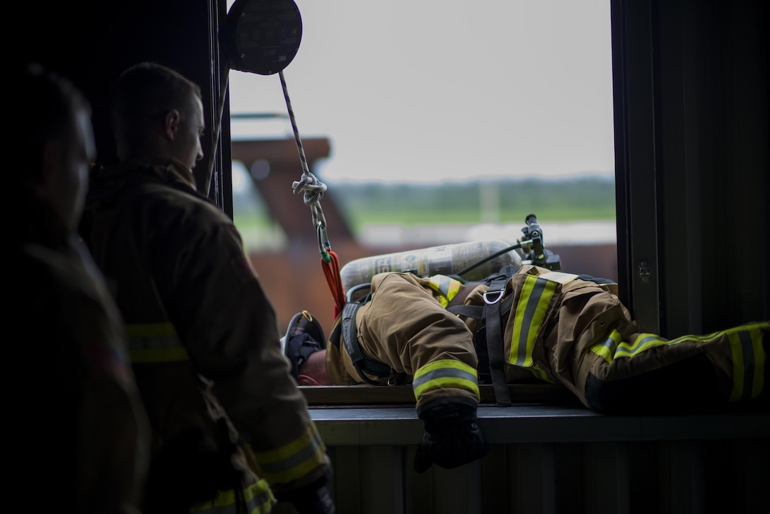 An Air Force Firefighter bails out of a second story window during a 5 day training course hosted by Niagara Falls Air Reserve Station, N.Y., July 12, 2017. Participants come from McGuire-Dix-Lakehurst, Fairchild, Dover, MacDill, and Grissom as well as Niagara. The course offers hands-on training for emergency situations in preparation of real-world situations. (U.S. Air Force photo by Tech. Sgt. Stephanie Sawyer)