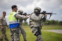 Airmen from the 914th Security Forces Squadron fire M4 rifles during annual training, July 11, 2017, Niagara Falls Air Reserve Station, N.Y. The training focuses on communication and execution of maneuvers, ensuring SFS Airmen are well versed in smoothly and efficiently carrying out procedures in real-world situations. (U.S. Air Force photo by Tech. Sgt. Stephanie Sawyer)