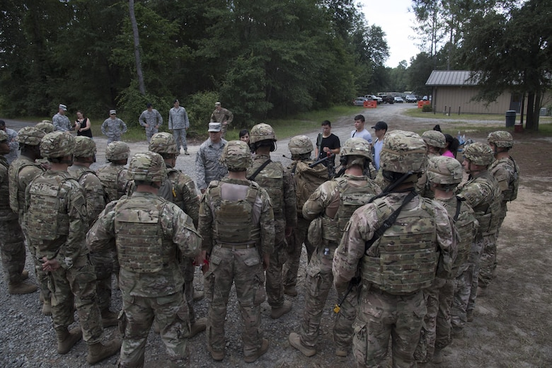Chief Master Sgt. David Wade, 9th Air Force command chief, talks to Airmen from the 823d Base Defense Squadron during a visit, July 11, 2017, at Moody Air Force Base, Ga. Wade visited the 93d Air Ground Operations Wing and its units at Moody to learn about the units' missions and capabilities. (U.S. Air Force photo by Staff Sgt. Eric Summers Jr.)