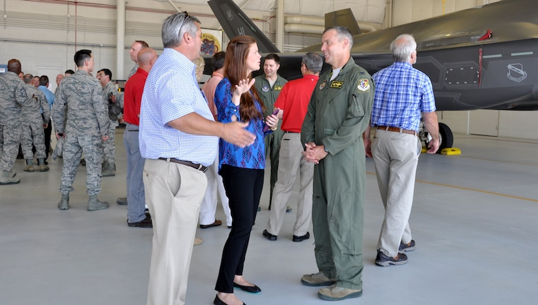 Col. David Smith, 419th Fighter Wing commander, talks to business leaders from Georgia about the F-35 Lightning II during an official Air Force civic leader tour at Hill Air Force Base, Utah, July 12.