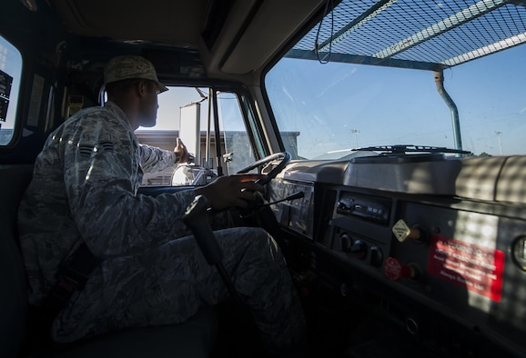 Senior Airman Darren Pizarro, 27th Special Operations Civil Engineer Squadron electrical systems specialist, drives his work truck to the next work site at Cannon Air Force Base, N.M., June 27, 2017. Pizarro and his peers at the base electrical shop have already handled over 600 requests this year. (U.S. Air Force photo by Senior Airman Lane T. Plummer)