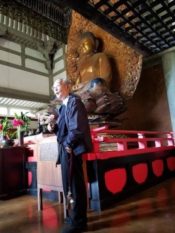 Bishop Fukuhara speaks to the Airmen of the 692nd Intelligence Surveillance Recognizance Group about the Buddhist faith and his personal experiences and spiritual journey in Phoenix Hall of the Byodo-in Temple. (Courtesy photo by Chaplain (Capt.) Ryan Ayers)