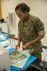 Petty Officer 3rd Class Carlotta Howard, a dental corpsman with 4th Dental Battalion, 4th Marine Logistics Group, Marine Forces Reserve, packages dental extraction tools to be sterilized for use during Innovative Readiness Training Louisiana Care 2017 at East St. John High School in Reserve, La., July 12, 2017. This year's IRT builds mutually beneficial civil-military partnerships between local communities to provide high quality, mission-essential training for service members and their units. (Photo by U.S. Marine Pvt. Samantha Schwoch/Released)