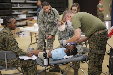 Air Force National Guardsmen and U.S. Navy personnel provide dental care during Innovative Readiness Training Louisiana Care 2017 at Assumption Community Center in Napoleonville, La., July 12, 2017. IRTs builds mutually beneficial civil-military partnerships between local communities and the military to provide high quality, mission essential training for service members and much needed medical care for civilians. (Photo by U.S. Marine Pvt. Samantha Schwoch/Released)