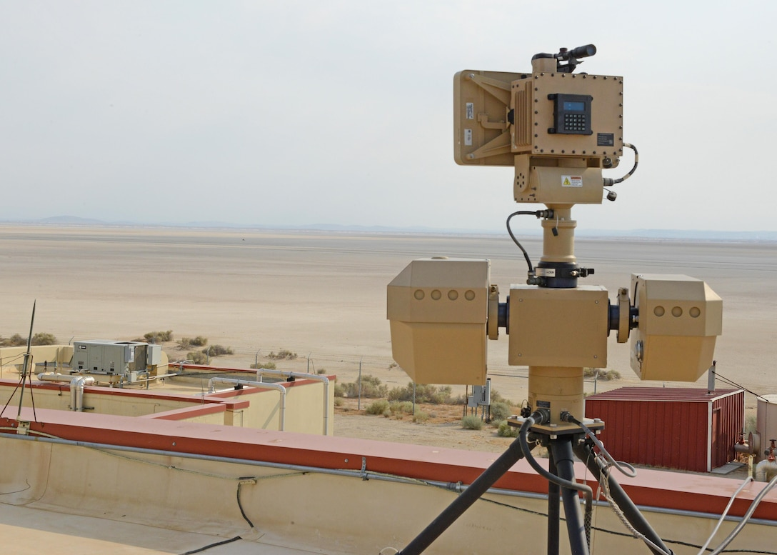 A surveillance system sits on top of a remote building at Edwards. The system was demonstrated to base leadership and 412th Security Forces Squadron personnel July 10. The ground-based radar system has the capability to monitor the lakebed at great distances with electro-optical and infrared sensors. (U.S. Air Force photo by Kenji Thuloweit)