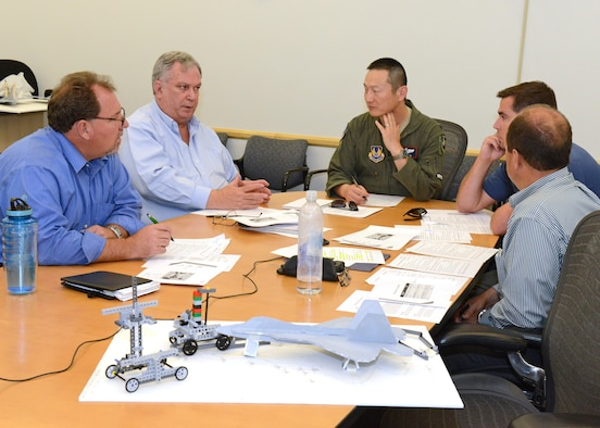 A panel of leaders from various Edwards Air Force Base, Calif., organizations decide which one of three design proposals to pursue following presentations during a July 10 innovation challenge. Pictured from left are Dan Osburn, 412th Test Engineering Group; Peter Burke, 412th Electronic Warfare Group; Lt. Col. Jeffrey Kwok, 412th Operations Group; Kyle Schaller, 771st Test Squadron; and Tony Rubino, 412th Range Squadron. (U.S. Air Force photo/Kenji Thuloweit)