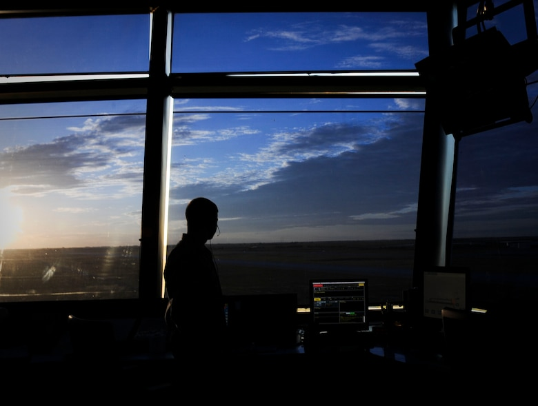 A 5th Operations Support Squadron air traffic control Airman watches the flight line at Minot Air Force Base, N.D., June 20, 2017. During any in-flight emergency, it's an air traffic controller's responsibility to get the aircraft safely on the ground by clearing the airspace, communicating with the aircrew and ensuring emergency personnel are prepared to meet the aircraft when it lands. (U.S. Air Force photo by Senior Airman Sahara L. Fales)