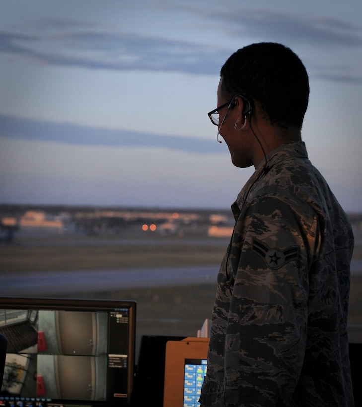 Airman 1st Class Malcolm Blair, 5th Operations Support Squadron air traffic control apprentice, watches a B-52H Stratofortress land at Minot Air Force Base, N.D, June 20, 2017. In addition to their extensive technical school training, air traffic control Airmen are required to complete their Control Tower Operator Certification and train on the simulator to prepare for any situation that may arise. (U.S. Air Force photo by Senior Airman Sahara L. Fales)