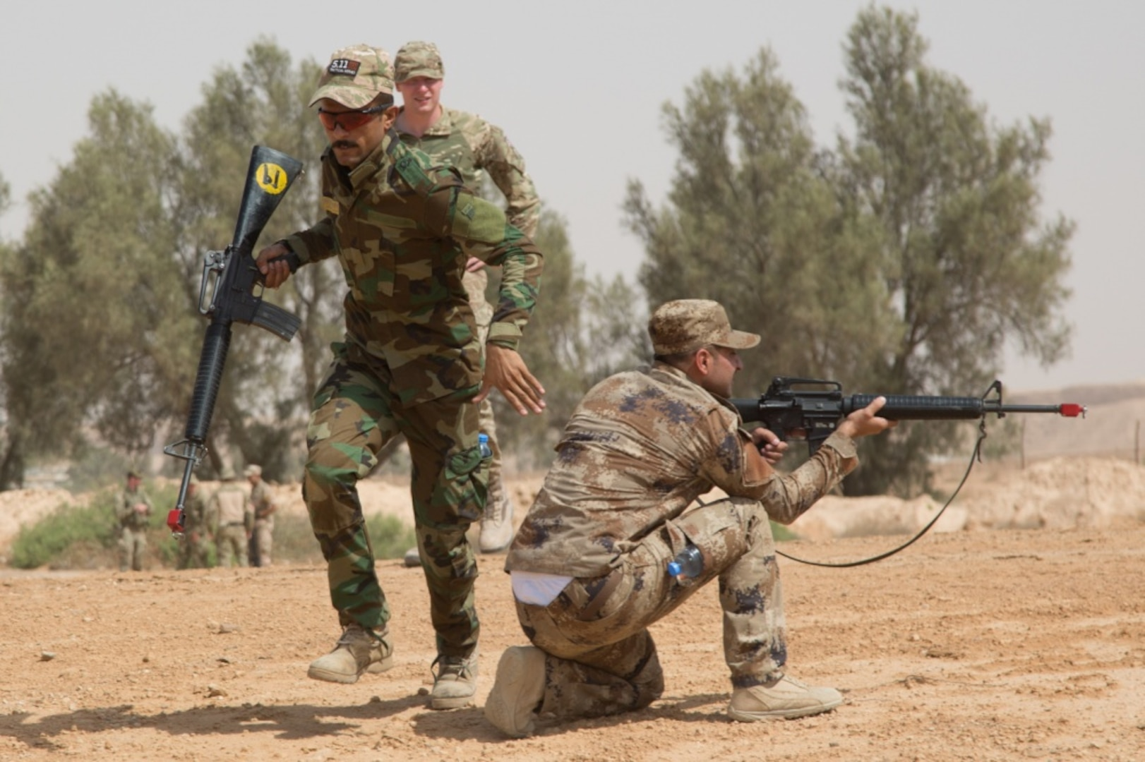 An Iraqi soldier rushes to regroup with his team as they return fire during a basic infantry class at Camp Al Asad, Iraq, July 4, 2017. The training is critical to enabling Iraqi forces to liberate their nation from the Islamic State of Iraq and Syria. Army photo by Spc. Cole Erickson