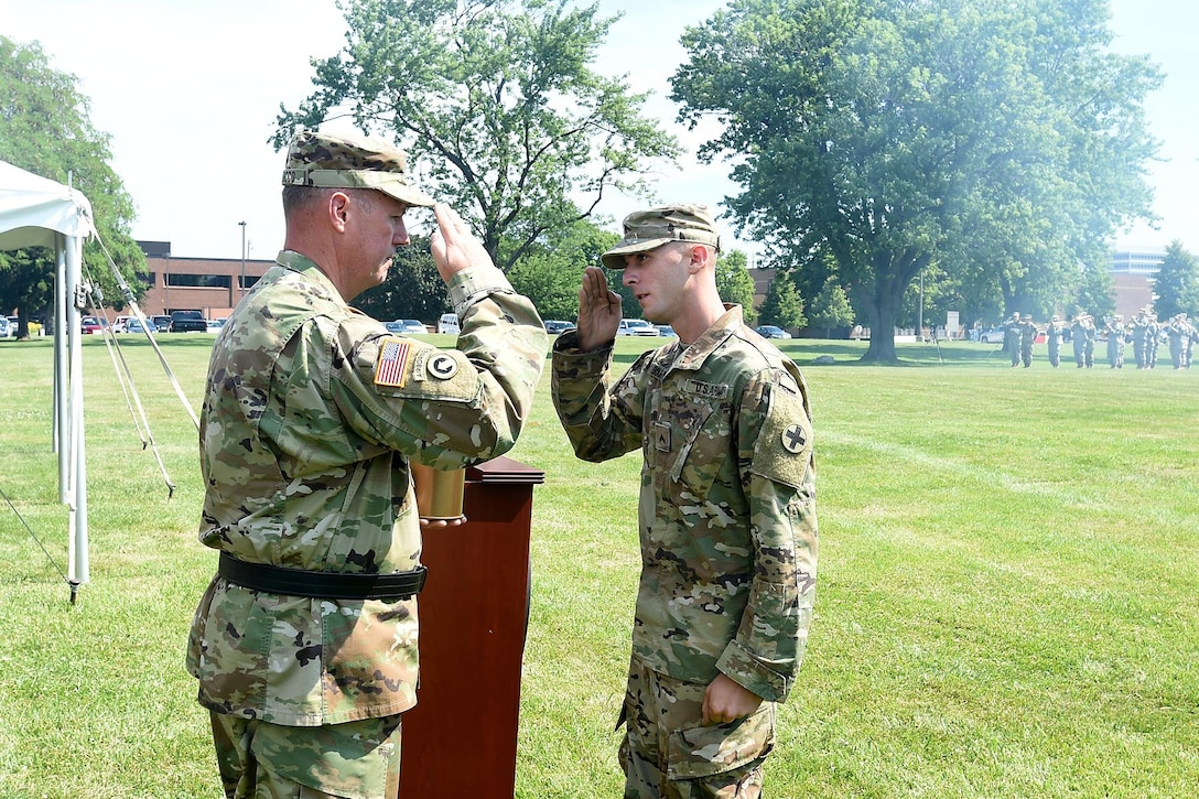 Brig. Gen. Frederick R. Maiocco Jr., Commanding General, 85th Support Command, receives a 105mm round casing resembling those fired from the Howitzer cannons, saluting his relinquishment of command on June 9, 2017 in Arlington Heights, Illinois. The salute battery is assigned to the Illinois National Guard's 2nd Battalion, 122nd Field Artillery Regiment, 33rd Brigade Combat Team. Maiocco served as the 85th Support Command's commanding general for three years. (U.S. Army photo by Sgt. Aaron Berogan/Released)