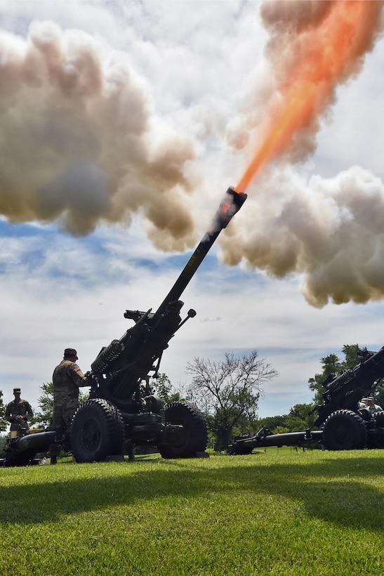 A howitzer cannon fires off a blank round to salute Brig. Gen. Frederick R. Maiocco Jr., Commanding General, 85th Support Command, during the 85th Support Command's relinquishment of command ceremony on June 9, 2019 in Arlington Heights, Illinois. Maiocco served there from August 1, 2014 to July 9, 2017. Maiocco will be moving on to take command of the 7th Mission Support Command in Germany. The new commander for the 85th SPT CMD is expected to take assumption of the unit in September. (U.S. Army photo by Sgt. Aaron Berogan/Released)