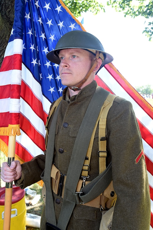 Army Reserve Staff Sgt. Walter Rodgers, Human Resources Sergeant, 85th Support Command, holds the American flag during the centennial anniversary of the 85th Support Command on June 9, 2017 at Arlington Heights, Illinois. The 85th SPT CMD color guard team wore World War I era uniforms in representation of the era the 85th Support Command's lineage was first formed.
