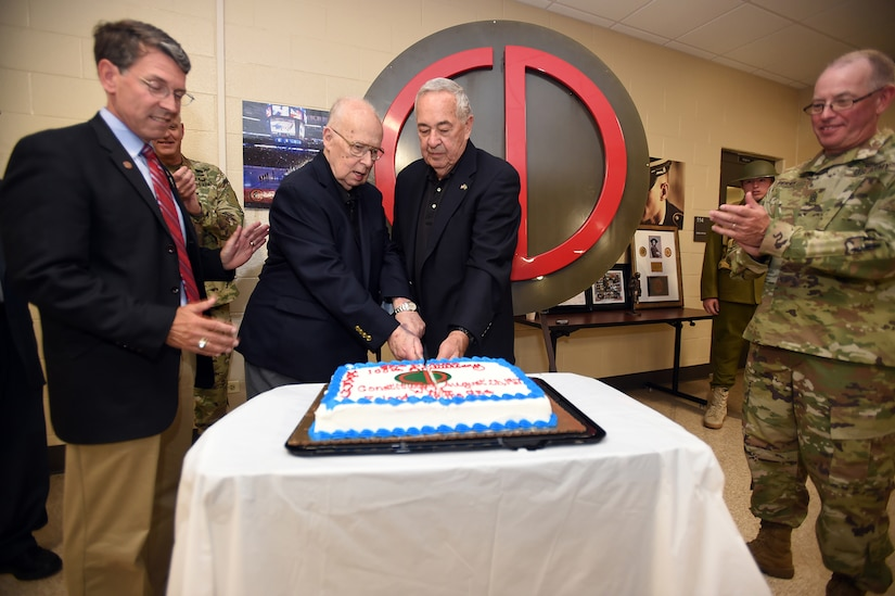 """Former Soldiers from the 85th Training Division and current members from the """"Friends of the 85th"""" Association cut a celebratory cake during a ceremony in honor of the 85th Support Command's 100th anniversary, June 9, 2017, in Arlington Heights, Illinois. The Army Reserve unit works side-by-side with First Army training Soldiers and ensuring that they are ready to deploy upon being called up. """"Friends of the 85th"""" members said that it is important now more than ever for units like the 85th SPT CMD to be here executing their mission and giving Soldiers what they need to come back home alive. (U.S. Army photo by Sgt. Aaron Berogan/Released)"""