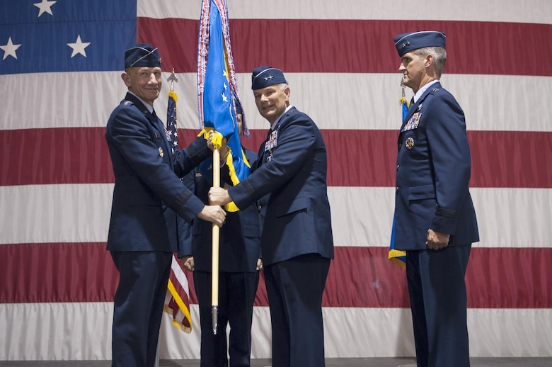 Gen. Mike Holmes, commander of Air Combat Command, poses with Maj. Gen. Glen VanHerck, commander of the U.S. Air Force Warfare Center during a change of command ceremony July 13, 2017 at Nellis Air Force Base, Nev. VanHerck transferred command of the USAFWC to Maj. Gen. Peter Gersten and will move on to a new assignment in Washington D.C. (U.S. Air Force photo by Senior Airman Joshua Kleinholz)