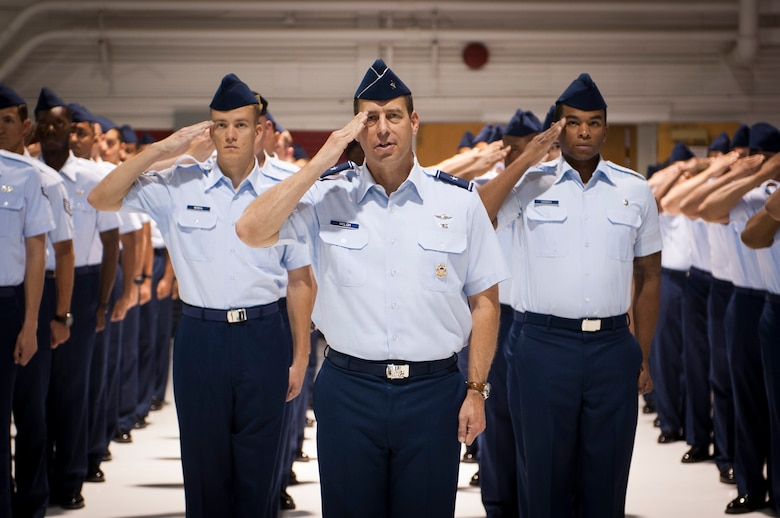 Brig. Gen. Paul Welch, U.S. Air Force Warfare Center vice commander, leads a formation comprised of Airmen representing various units across Nellis Air Force Base in rendering a traditional first salute during a change of command ceremony July 13, 2017, at Nellis AFB, Nev. The USAFWC exists to ensure deployed forces are well trained and well equipped to conduct integrated combat operations. (U.S. Air Force photo by Senior Airman Joshua Kleinholz)