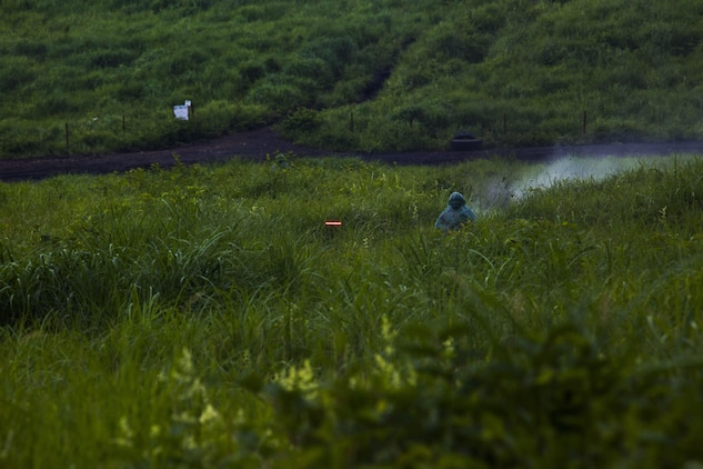 A U.S. Marine with Marine Wing Support Squadron (MWSS) 171, based out of Marine Corps Air Station Iwakuni, shoots a tracer round downrange with a M240B machine gun during phase two of Eagle Wrath 2017 at Combined Arms Training Center Camp Fuji, Japan, July 5, 2017. Phase two consisted of conducting live-fire training exercises to give MWSS-171 the knowledge and confidence to utilize weapons systems effectively in a deployed environment. (U.S. Marine Corps photo by Lance Cpl. Stephen Campbell)