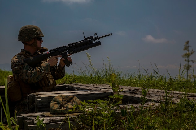 U.S. Marine Corps Pfc. Cody Burkhardt, a combat engineer with Marine Wing Support Squadron (MWSS) 171, based out of Marine Corps Air Station Iwakuni, shoots an M203 grenade launcher during phase two of Eagle Wrath 2017 at Combined Arms Training Center Camp Fuji, Japan, July, 10, 2017. Phase two consisted of conducting live-fire training exercises to give MWSS-171 the knowledge and confidence to utilize weapons systems effectively in a deployed environment. (U.S. Marine Corps photo by Lance Cpl. Stephen Campbell)