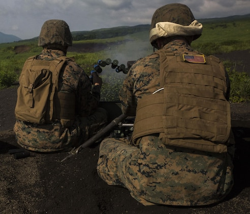 A U.S. Marine with Marine Wing Support Squadron (MWSS) 171, based out of Marine Corps Air Station Iwakuni, shoots a Mark 19 40 mm grenade machine gun during phase two of Eagle Wrath 2017 at Combined Arms Training Center Camp Fuji, Japan, July 7, 2017. Phase two consisted of conducting live-fire training exercises to give MWSS-171 the knowledge and confidence to utilize the weapons systems effectively in a deployed environment. (U.S. Marine Corps photo by Lance Cpl. Stephen Campbell)