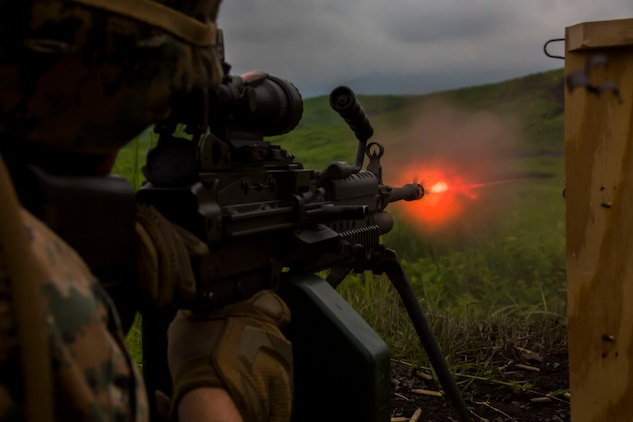 A U.S. Marine with Marine Wing Support Squadron (MWSS) 171, based out of Marine Corps Air Station Iwakuni, shoots an M249 machine gun during phase two of Eagle Wrath 2017 at Combined Arms Training Center Camp Fuji, Japan, July, 5, 2017. Phase two consisted of conducting live-fire training exercises to give MWSS-171 the knowledge and confidence to utilize weapons systems effectively in a deployed environment. (U.S. Marine Corps photo by Lance Cpl. Stephen Campbell)