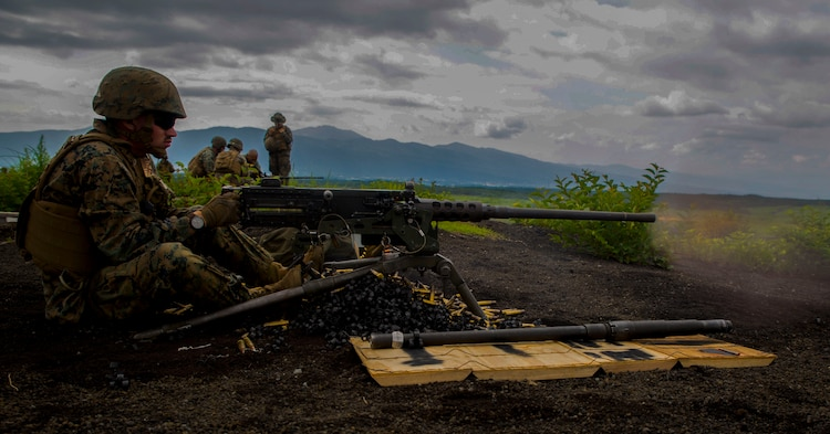 U.S. Marine Corps Pfc. Slade Wood, a cyber network operator with Marine Wing Support Squadron (MWSS) 171, based out of Marine Corps Air Station Iwakuni, shoots an M2 machine gun during phase two of Eagle Wrath 2017 at Combined Arms Training Center Camp Fuji, Japan, July 6, 2017. Phase two consisted of conducting live-fire training exercises to give MWSS-171 the knowledge and confidence to utilize weapons systems effectively in a deployed environment. (U.S. Marine Corps photo by Lance Cpl. Stephen Campbell)
