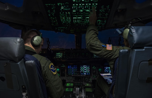 Maj. Timothy Birt and Capt. Greg Sewell, U.S. Air Force C-17 Globemaster III pilots from the 15th Airlift Squadron, 437th Airlift Wing, Joint Base Charleston, S.C., conduct pre-flight checks on the ramp at Joint Base Elmendorf-Richardson, Alaska prior to takeoff July 12, 2017 to participate in and provide airlift support for Exercise Talisman Saber 2017. The purpose of TS17 is to improve U.S.-Australian combat readiness, increase interoperability, maximize combined training opportunities and conduct maritime prepositioning and logistics operations in the Pacific. TS17 also demonstrates U.S. commitment to its key ally and the overarching security framework in the Indo Asian Pacific region.