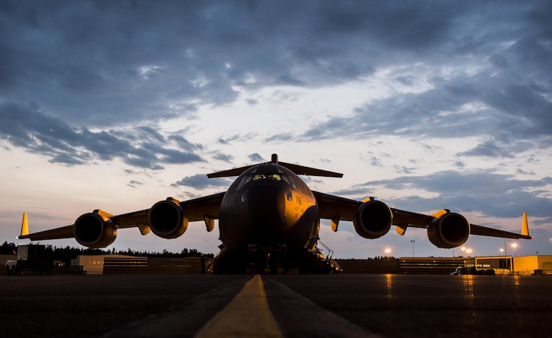 A U.S. Air Force C-17 Globemaster III from Joint Base Charleston, S.C., sits on the ramp at Joint Base Elmendorf-Richardson, Alaska prior to takeoff July 12, 2017 to participate in and provide airlift support for Exercise Talisman Saber 2017. The purpose of TS17 is to improve U.S.-Australian combat readiness, increase interoperability, maximize combined training opportunities and conduct maritime prepositioning and logistics operations in the Pacific. TS17 also demonstrates U.S. commitment to its key ally and the overarching security framework in the Indo Asian Pacific region.