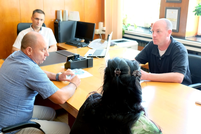 U.S. Army Sgt. 1st Class Robert Ritsema, right, a civil affairs noncommissioned officer with the 415th Civil Affairs Battalion, speaks to Senior Police Commissioner Ivan Rusev, center, and Senior Director Dimitar Velichkov, left, while speaking through Hristina Dobreva, bottom, an interpreter, July 13, 2017 in Sliven, Bulgaria.